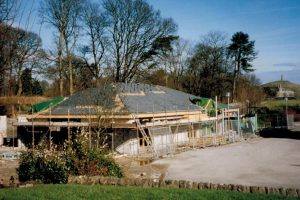 The Daltongate office under construction in 1999, The Hoad monument in the background